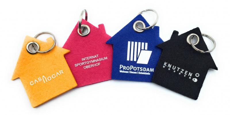 Beispiele Filz Schlüsselanhänger Haus mit verschiedenen Werbedrucken
