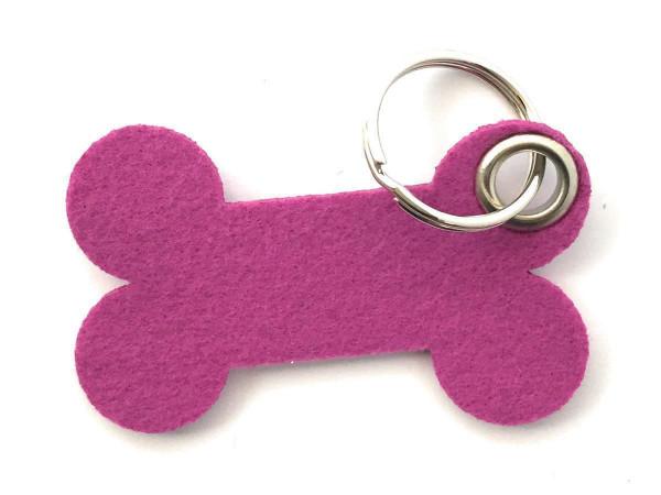 Knochen / Hundeknochen - Filz-Schlüsselanhänger - Farbe: magenta - optional mit Gravur / Aufdruck