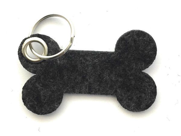 Knochen / Hundeknochen - Filz-Schlüsselanhänger - Farbe: schwarz meliert - optional mit Gravur / Auf