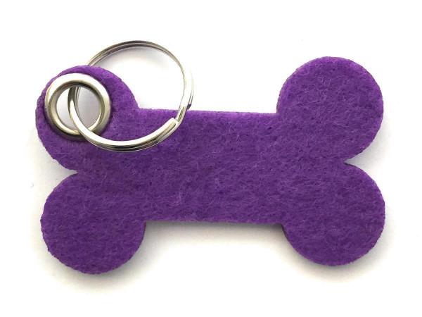 Knochen / Hundeknochen - Filz-Schlüsselanhänger - Farbe: lila / flieder - optional mit Gravur / Aufd